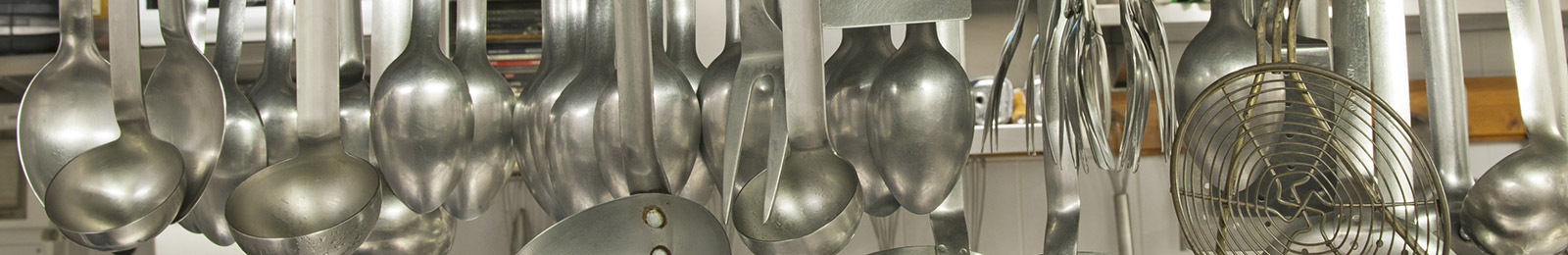 close-up of a rack of ladles and serving spoons